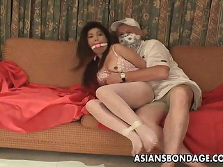 Asian slut is getting roped up and..