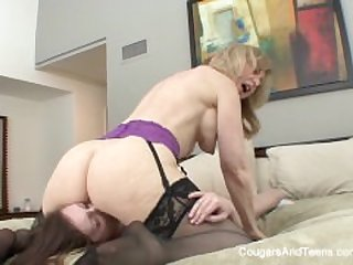 Busty MILF Nina gives her stepdaughter a..